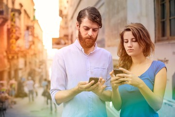 Man and woman using their smart phones
