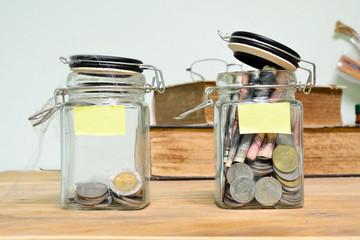 Jar for savings full of coins.