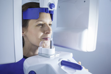 A dental X-Ray scanner scanning a woman