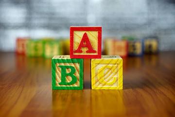 Arrangement of ABC letters using colorful wooden alphabet blocks.Selective focus,shallow depth of field.