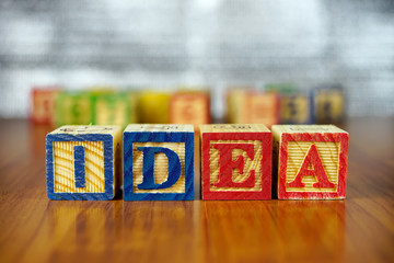 Word of IDEA spelled with colorful wooden alphabet blocks.Selective focus,shallow depth of field.