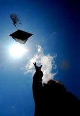 A graduate tosses a cap.