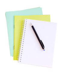 School office subjects bright notebooks an empty notebook on a white background the isolated. School office  the isolated
