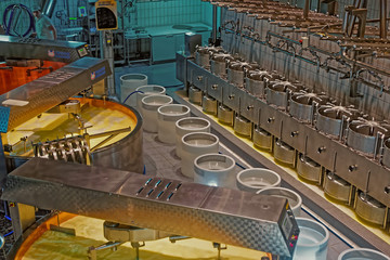 Production of Gruyere cheese at the modernly equipped cheese mak