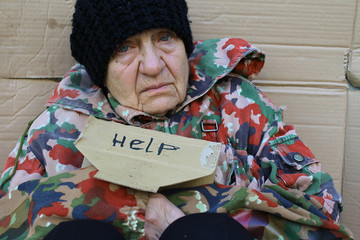Homeless women sitting on a street