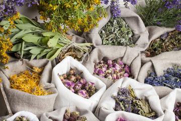 Healing medical herbs in a linen sacks.