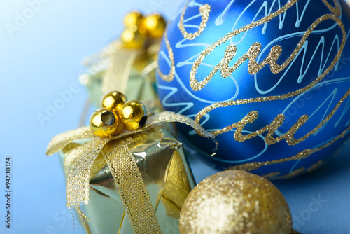 Christmas ball blue and gold with gift box present on for Blue and gold christmas