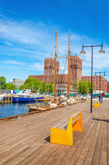 Oslo City Hall and wooden pier of Fjord, Norway
