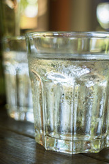 Glass of melt iced water