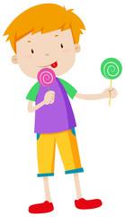 Boy eating two lolipops
