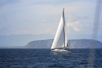 Ship yacht with white sails in the Sea. Sailing yacht race.