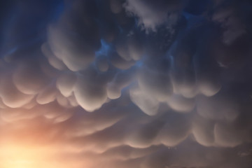 Mammatus clouds are pouch-like cloud structures. It's a strange and very rare formations of clouds in sinking air.