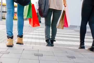 Closeup of girls rushing across the pedestrian crossing