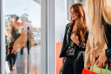 Girl looking in the window of the new store
