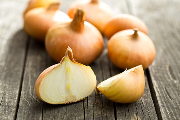 halved fresh onion on wooden table