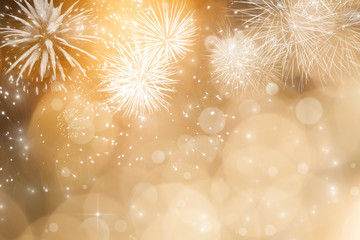Abstract holiday background with fireworks and sparkling lights