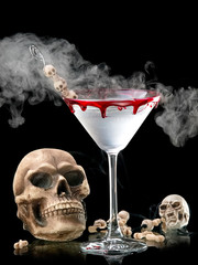 Bloody Halloween skull martini with smoke