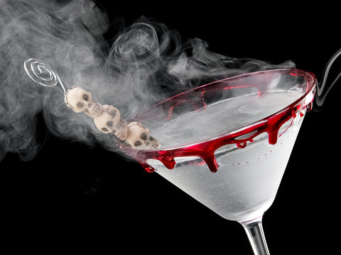 Bloody Halloween skull martini with smoke, close up