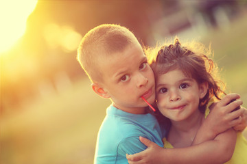 Brother and sister in hug with love and big happy smile. Shalow