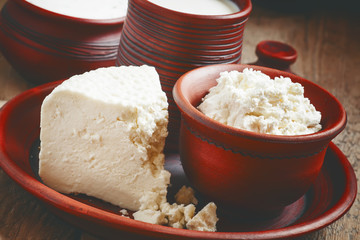 Homemade cottage cheese in a brown pottery bowl in country style