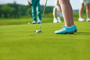 Kids playing golf