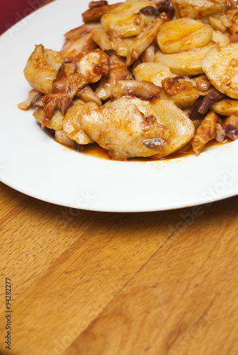 Zdjęcie: Octopus with paprika and potatoes on a white plate, also ...