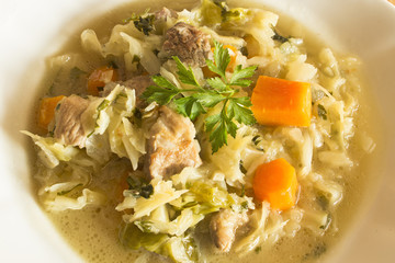 Boiled cabbage with pork and vegetables