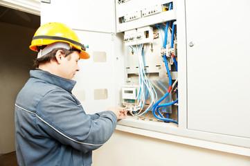 Electrician installing energy saving meter
