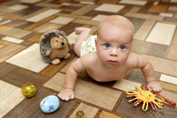 Serious baby crawling on the floor