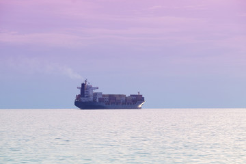The image of a cargo ship in a open sea