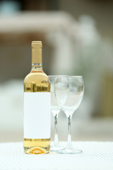 Wine bottle and glass on the table