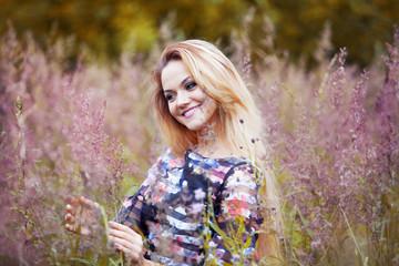 Beauty Girl Outdoors enjoying nature, beautiful girl in flower