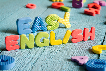 English is easy to learning concept with letters on blue boards