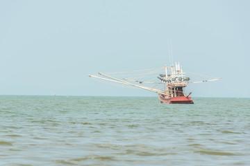 Fishing boat in sea, fishing for squid.