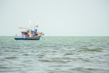 Fishing boat in sea, fishing for squid.
