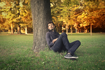 Man sitting in the park looking away