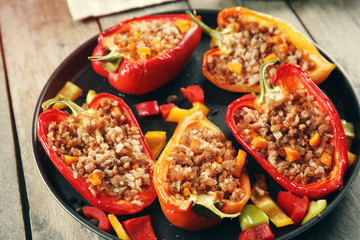 Stuffed peppers with vegetables on table close up