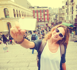 young beautiful woman making Selfe in a tourist location