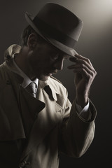 Detective adjusting his hat