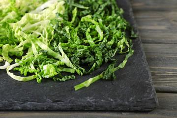 Cut savoy cabbage on wooden background