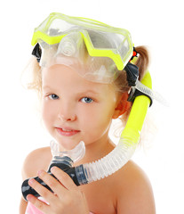 Happy blonde little girl with diving mask isolated on white background