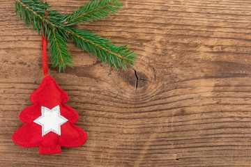 Christmas tree decoration with fir branch over wood
