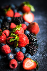 Berry mix on rustic black background