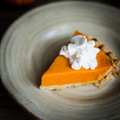Pumpkin pie on rustic wooden background