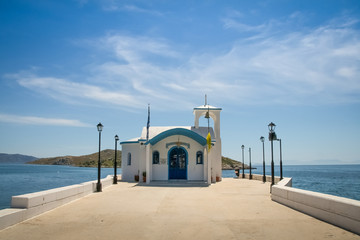 Perspective image of a Small greek orthodox chapel with some clouds above