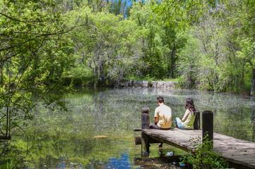 Couple enjoying the spring in a fantasy lake