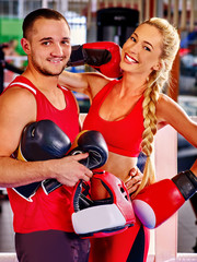 Female boxer with your male coach after workout.