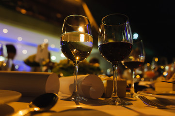 Wine glasses on a festive table in the evening