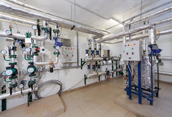 heat substations interior with lots of pipes, gauges and measuri