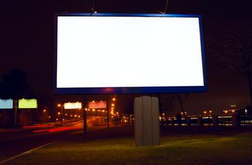 Big white billboard on night street